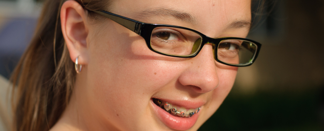 Girl with Glasses & Braces