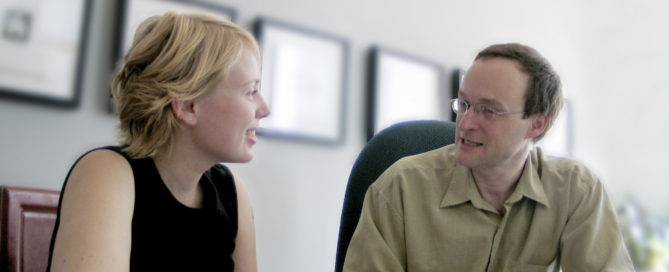 orthodontist reviews treatment plan with patient