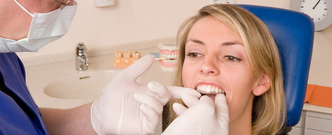 orthodontist fits patient with invisalign
