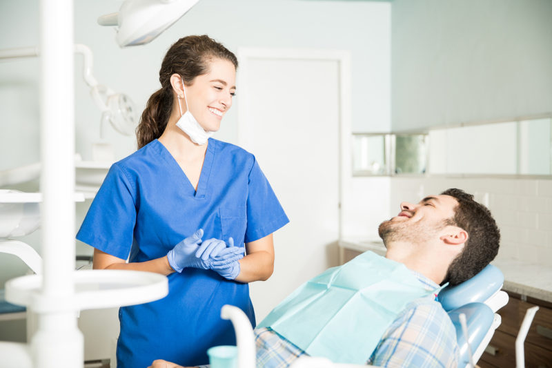 orthodontist tells patient about invisalign